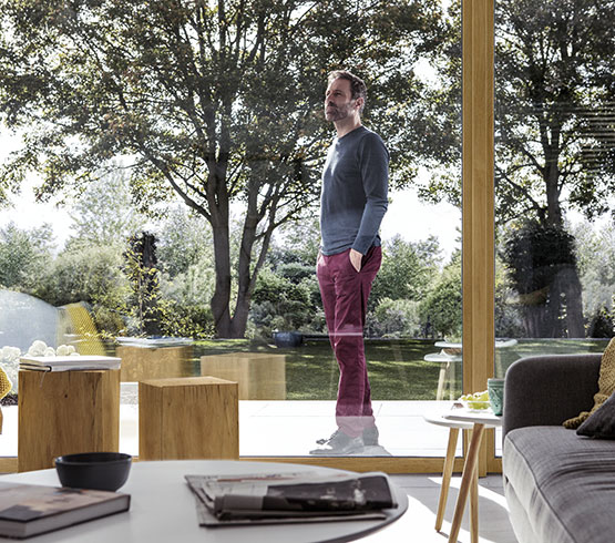 Man standing outside his patio doors