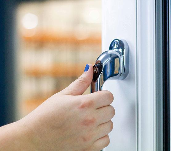 UPVC Windows - A hand holding the window handle